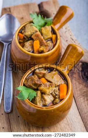 Portion of traditional beef stew with carrots. studio shot - stock photo