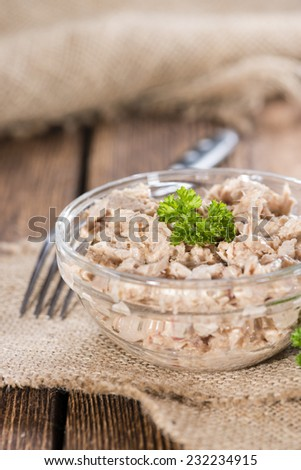 Portion of Tuna salad in a small bowl (close-up shot)