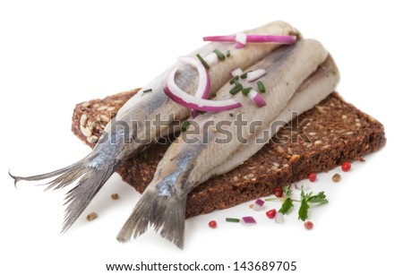 Portion of typical Dutch herring on bread on white Background - stock photo