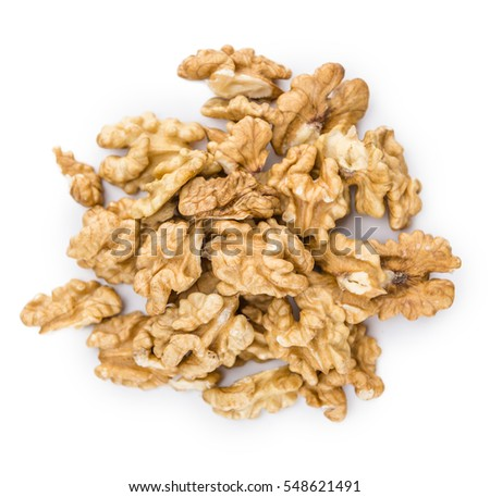 Portion of Walnut kernels (as close-up shot) isolated on white background