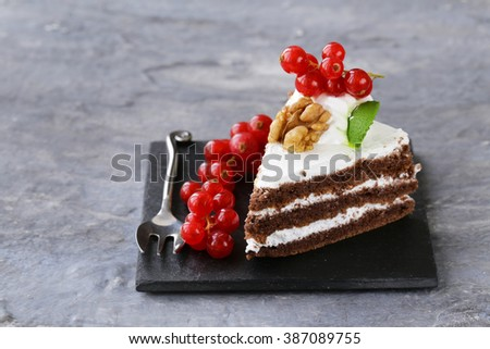 portioned dessert piece of cake with cream and berries  - stock photo
