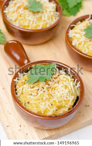 portioned form with baked chicken with mashed cauliflower and cheese, top view, vertical - stock photo