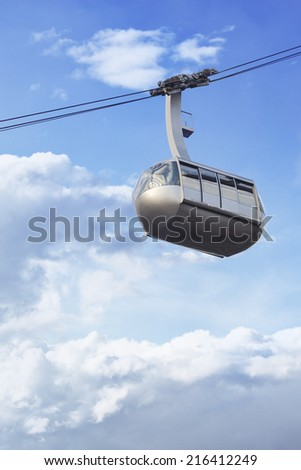 Portland aerial tram for public transportation to Oregon Health and Science University on a cloudy sky - stock photo