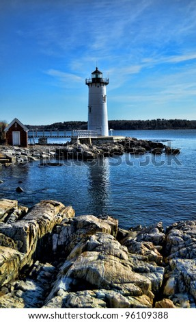 Portland Harbor Lighthouse with rocky shore in foreground, Portsmouth, New Hampshire.