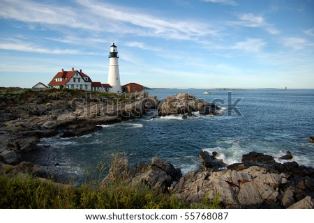 Portland Head Light along the shores of Fort Williams Park in Cape Elizabeth, Maine.  Ram Island Ledge Light in Casco Bay can be seen in the background - stock photo