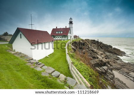 Portland Head Light on overcast day, Portland, Maine, USA - stock photo