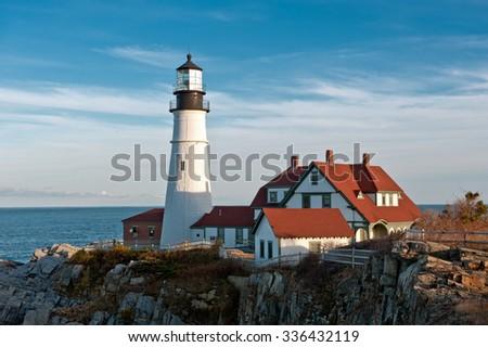 Portland Head Lighthouse on a clear, sunny fall day. - stock photo