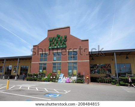 PORTLAND, MAINE - JUNE 1, 2014: Whole Food Market exterior and sign on a clear day. Whole Foods is an American foods supermarket chain specializing in natural and organic foods.  - stock photo