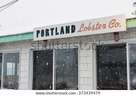 PORTLAND, MAINE, USA - JANUARY 16, 2016: Portland Lobster Company in a snow storm on January 16th. Portland Maine is a popular tourist destination in the summer, but many business close for winter.
