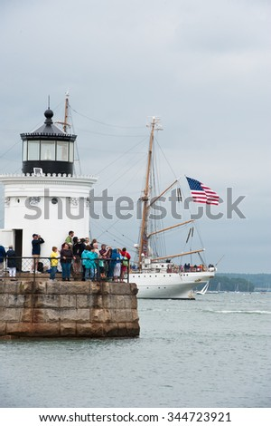 PORTLAND, MAINE, USA - JULY 18, 2015: The United States Coast Guard Cutter Eagle sails past Bug Lighthouse. The Eagle is the only active commissioned sailing vessel in American military service