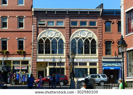 PORTLAND, ME - AUG 24: Portland Seamans Club at Old Port. This area is filled with 19th century brick buildings and is now the commercial center of the city, August 24th, 2014 in Portland, Maine, USA. - stock photo