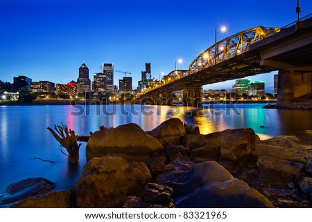 Portland Oregon City Skyline along Willamette River at Blue Hour - stock photo