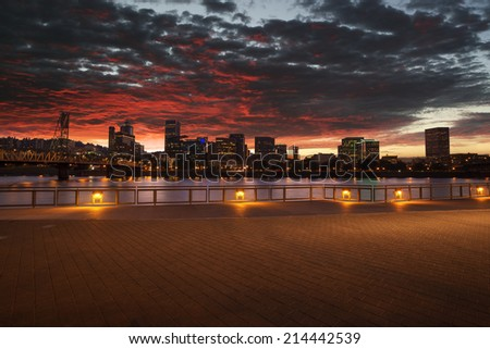 Portland, Oregon city skyline panorama with Hawthorne bridge. Cloudy sunset with dramatic sky and light reflection on the Willamette river. - stock photo