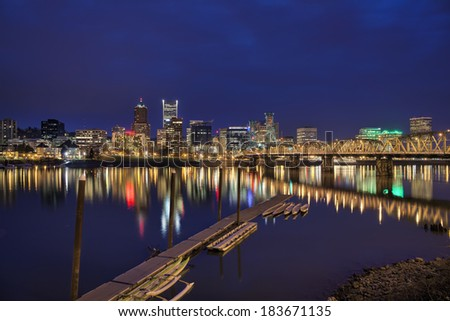 Portland Oregon City Waterfront Skyline Along Willamette River at Evening Blue Hour - stock photo