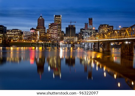 Portland Oregon Downtown City Skyline with Hawthorne Bridge along Willamette River at Blue Hour
