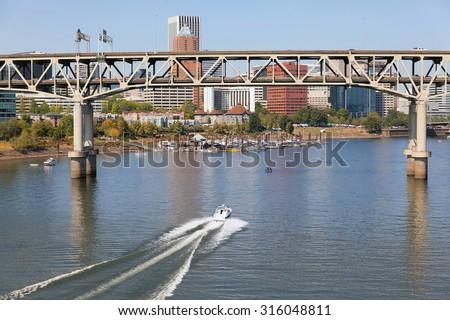 Portland Oregon Downtown City Skyline with Marquam Bridge Along Willamette River Daytime - stock photo
