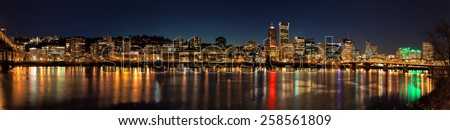Portland Oregon Downtown Waterfront City Skyline Along Willamette River Night Scene Panorama - stock photo