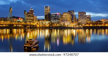 Portland Oregon Downtown Waterfront  Skyline along Willamette River at Blue Hour Twilight - stock photo