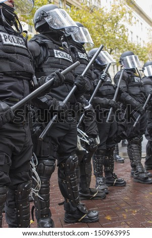 PORTLAND, OREGON - NOV 17: Police in Riot Gear Frontline in Downtown Portland, Oregon during a Occupy Portland protest on the first anniversary of Occupy Wall Street November 17, 2011 - stock photo