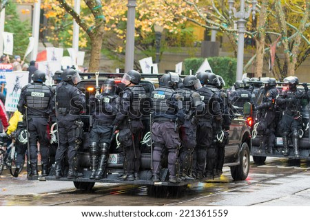 PORTLAND, OREGON - NOVEMBER 17, 2011: Police in Riot Gears on Vehicles in Downtown Portland, Oregon during a Occupy Portland Protest Against Banks on the first anniversary of Occupy Wall Street - stock photo