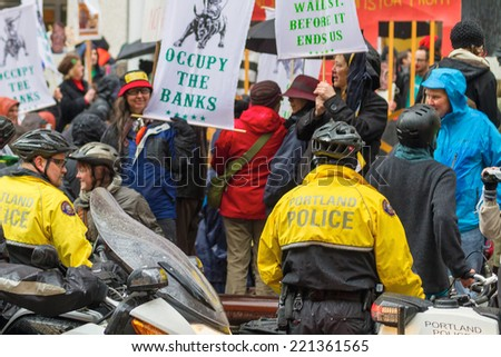 PORTLAND, OREGON - NOVEMBER 17, 2011: Portland Police in Downtown Portland, Oregon during a Occupy Portland Protest Against Banks on the first anniversary of Occupy Wall Street - stock photo