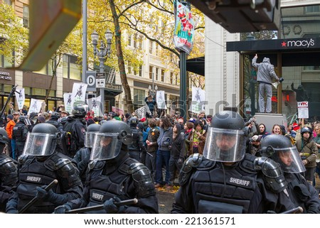 PORTLAND, OREGON - NOVEMBER 17, 2011: Portland Police in the streets of Downtown Portland, Oregon during a Occupy Portland Protest Against Banks on the first anniversary of Occupy Wall Street - stock photo