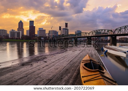 Portland, Oregon Panorama.  Sunset scene with dramatic sky and light reflections on the Willamette River. - stock photo