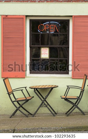 Portland Oregon restaurant sidewalk service with table and chairs - stock photo