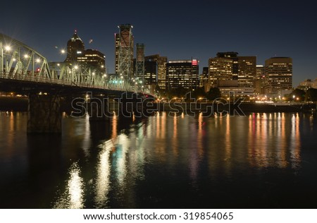 Portland Oregon skyline buildings and bridge at night. - stock photo
