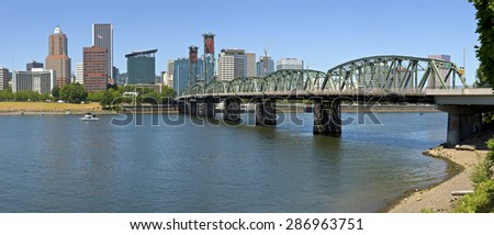 Portland Oregon skyline downtown buildings and the Hawthorne bridge. - stock photo