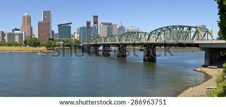 Portland Oregon skyline downtown buildings and the Hawthorne bridge. - stock photo
