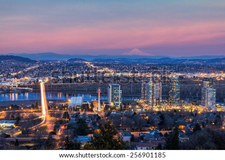 Portland Oregon South Waterfront with Ross Island Bridge Mount Hood Along Willamette River during Alpenglow Sunset - stock photo