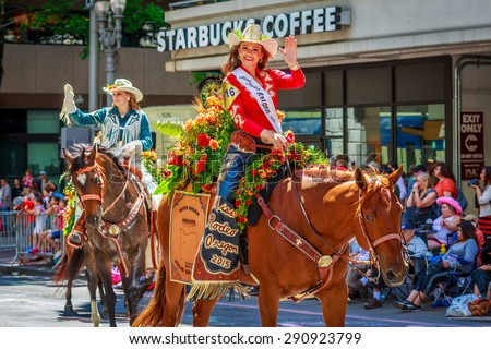 Portland, Oregon, USA - June 6, 2015: Miss Rodeo Oregon, Julie Drescher, in the Grand Floral Parade during Portland Rose Festival 2015.