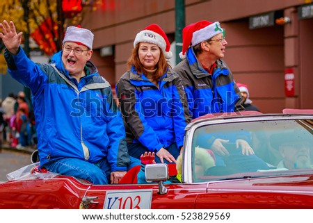 Portland, Oregon, USA - November 25, 2016: K103 Radio station marches in the annual My Macy's holiday Parade across Portland Downtown.