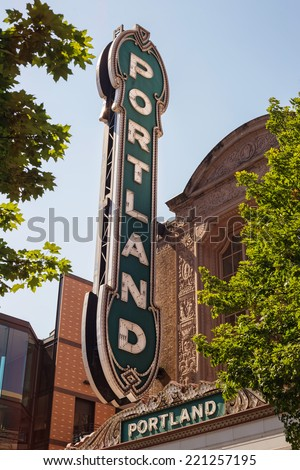 Portland sign between green tree branches with leaves - stock photo