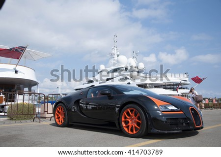PORTO CERVO, ITALY - AUGUST 15: 2014 Bugatti Veyron black and orange - stock photo