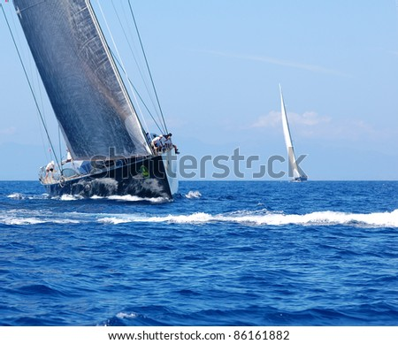 PORTO CERVO, ITALY - SEPTEMBER 10: Participants in the Maxi Yacht Rolex Cup boat race (Team unidentified), on September 10,2011 in Porto Cervo, Italy - stock photo