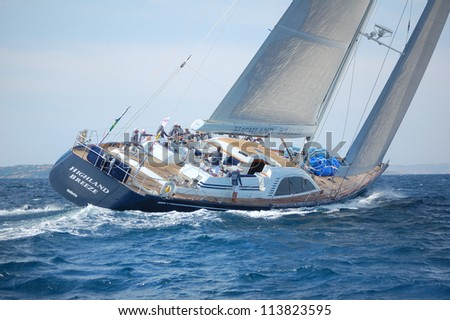 PORTO CERVO, ITALY - SEPTEMBER 12: team yacht highland breeze compete in the Rolex Swan Cup boat race on September 12, 2012 in Porto Cervo, Italy. - stock photo