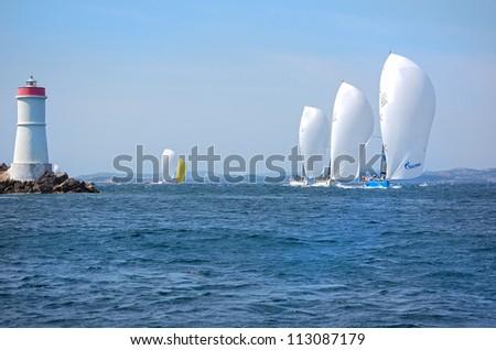PORTO CERVO, ITALY - SEPTEMBER 12:  Yachts  in the  Rolex Swan Cup boat race on September 12, 2012 in Porto Cervo, Italy. - stock photo