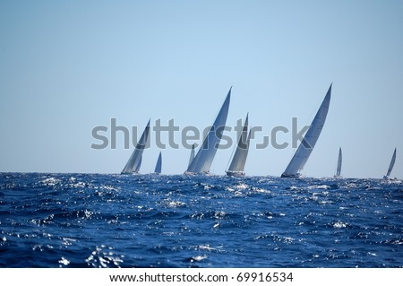 PORTO CERVO - SEPTEMBER 11: Participants in the Maxi Yacht Rolex Cup boat race, on September 11, 2010 in Porto Cervo, Italy - stock photo