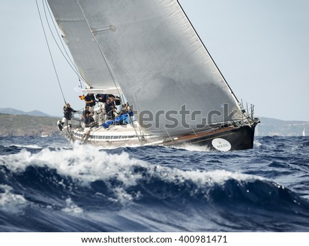 PORTO CERVO - 8 SEPTEMBER: team competing on Maxi Yacht Rolex Cup sail boat race in Sardinia, on September 8 2015 in Porto Cervo, Italy - stock photo