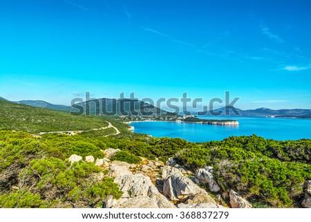 Porto Conte bay under a blue sky, Italy - stock photo