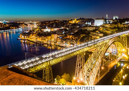 Porto evening skyline cityscape with Douro River and Dom Luis I Bridge in Porto, Portugal - stock photo