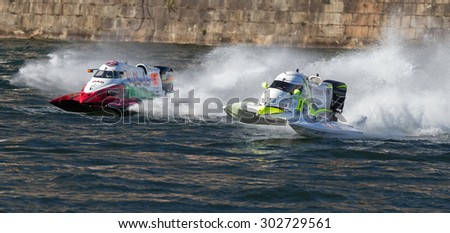 PORTO - GAIA, PORTUGAL - AUGUST 2, 2015: Philippe Chiappe (FRA) flying to victory during the U.I.M. F1H2O World Championship in Porto & Gaia, Portugal.  - stock photo