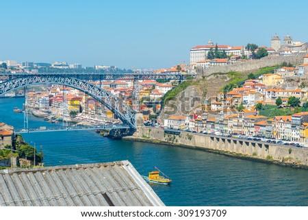 Porto historic city centre with Ponte Luis I Bridge over Douro river in Portugal - stock photo
