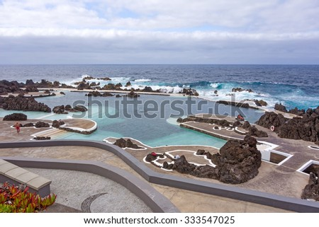 Porto Moniz, Portugal - June 2, 2013: Natural rock pool of Porto Moniz. It is a public bath with water from the Atlantic Ocean. - stock photo