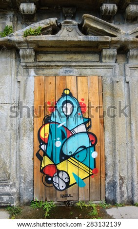 PORTO, PORTUGAL - APRIL 26, 2015: Virgin Mary by graffiti artist Hazul Luzah. Hazul incorporates the Virgin Mary image in many of his works which based on the decorative calligraphic forms. - stock photo