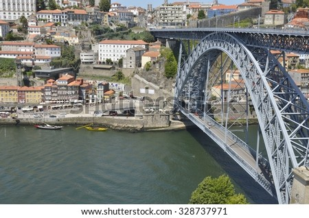 PORTO, PORTUGAL - AUGUST 7: The Dom Luis  Bridge, an iron bridge that spans the Douro River in Porto, Portugal on August 7, 2015.