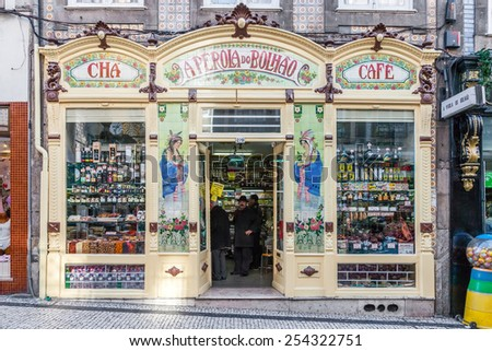 Porto, Portugal. December 29, 2014: A Perola do Bolhao grocery store. This historical delicatessen shop is decorated in the Art-Nouveau style and dedicated to sell traditional Portuguese products. - stock photo