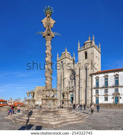 Porto, Portugal. December 29, 2014: Pillory in the Cathedral Square aka Terreiro da Se, with Porto Cathedral or Se Catedral do Porto behind. Romanesque and Gothic. Unesco World Heritage Site - stock photo
